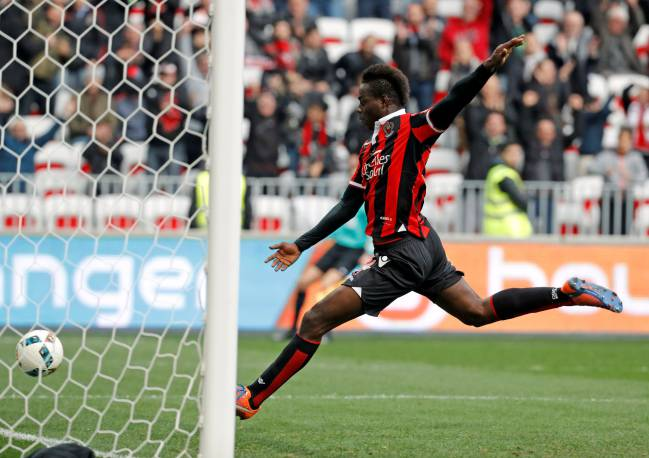 More fun than TV: Nice's Mario Balotelli scores the third goal against Guingamp.
