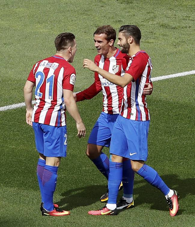 Atletico's trio celebrate during a game