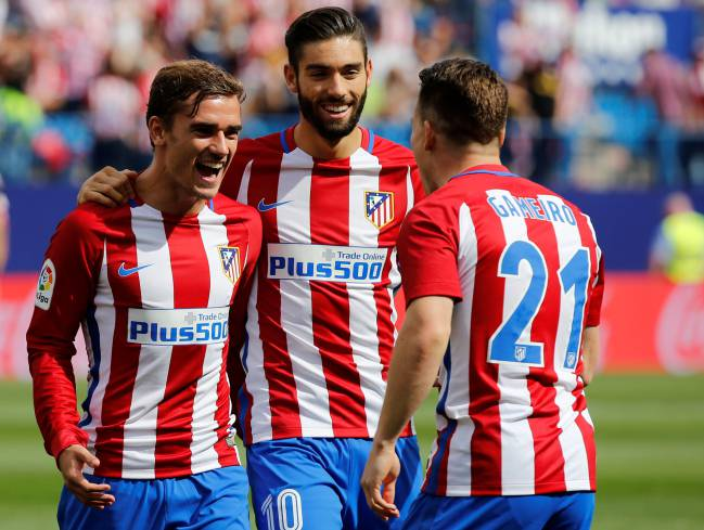 Atletico Madrid's Antoine Griezmann celebrates a goal with teammates Yannick Ferreira-Carrasco and Kevin Gameiro.