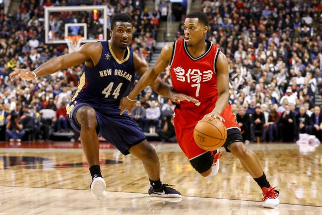Toronto Raptors guard Kyle Lowry drives to the net against New Orleans Pelicans forward Solomon Hill during the second half at Air Canada Centre.