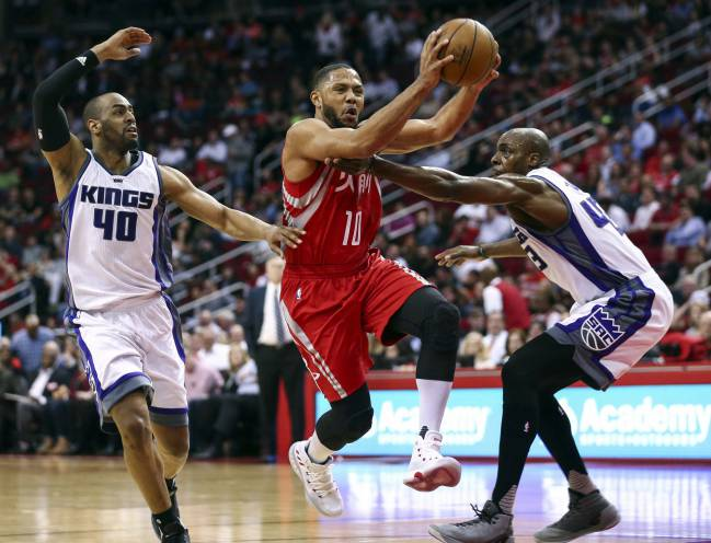 Houston Rockets guard Eric Gordon takes the ball to the basket as Sacramento Kings forward Anthony Tolliver defends during the second quarter at Toyota Center.