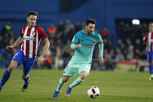 Barcelona's Messi in full flow against Atlético in the Copa del Rey semi-final.