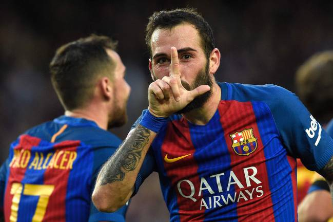 Barcelona's defender Aleix Vidal celebrates his side's third.