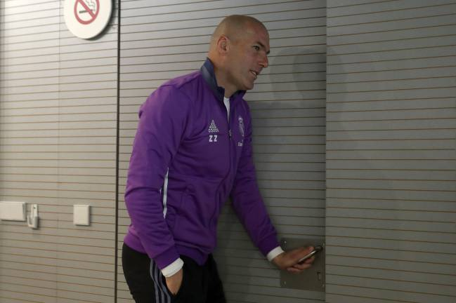 Zinedine Zidane leaving the press conference ahead of the Osasuna game.