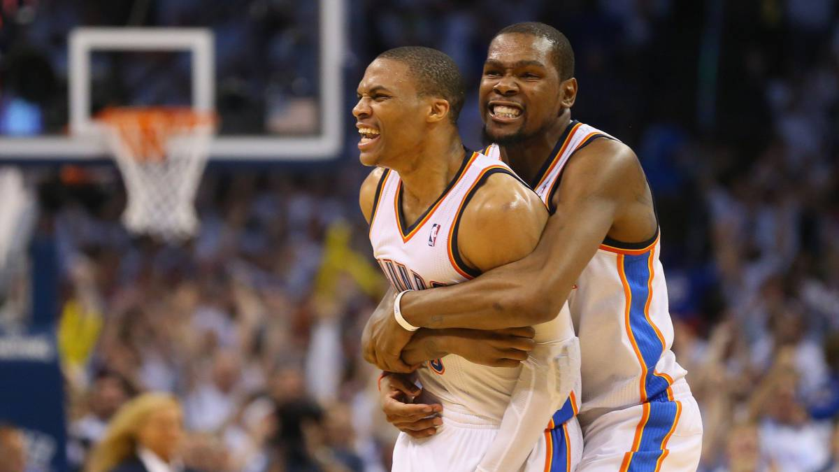 Russell Westbrook #0 and Kevin Durant celebrate a 105-104 win against the Los Angeles Clippers in Game Five of the Western Conference Semifinals