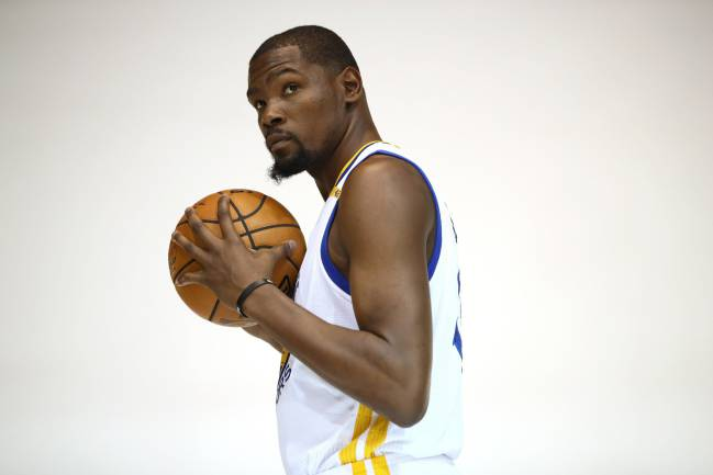 Kevin Durant #35 of the Golden State Warriors poses for NBA team photographer Noah Graham during the Golden State Warriors