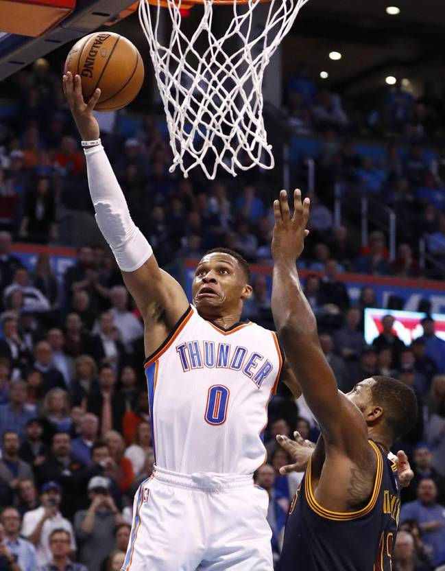 Tristan Thompson tries to block Russell Westbrook's layup during the Thunder's victory over the Cavaliers.