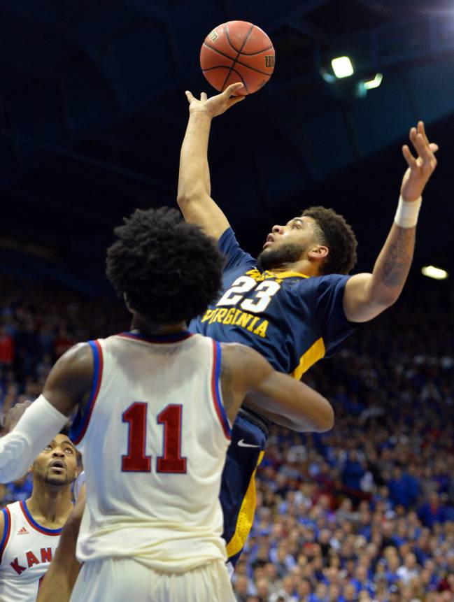 West Virginia Mountaineers forward Esa Ahmad shoots as Kansas Jayhawks guard Josh Jackson defends