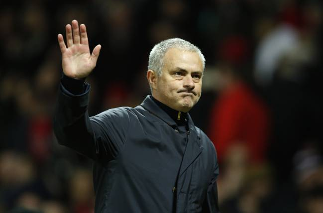 Manchester United manager Jose Mourinho waves to fans after the game.