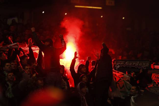 Noisy St Etienne fans light flares in Old Trafford.