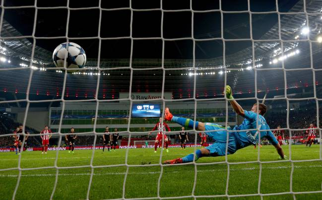 Kevin Gameiro of Atletico scores the 3rd goal by penalty kick during the UEFA Champions League match between Atletico and Bayer