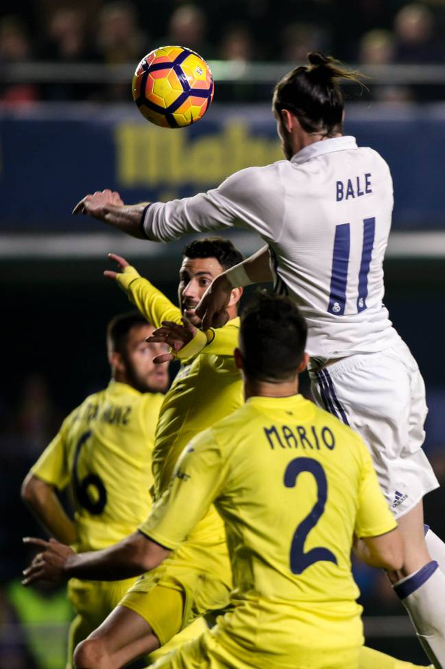 Real Madrid's Welsh forward, Gareth Bale, heads the ball to score a record-equalling feat.