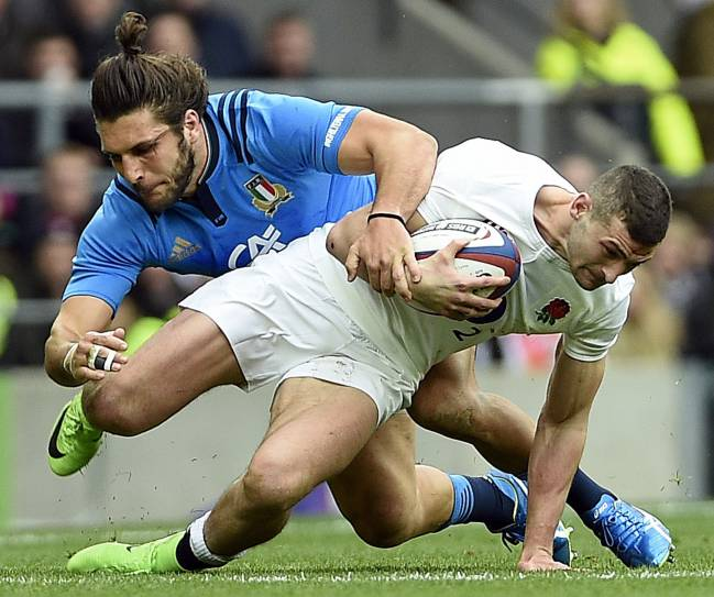 England's Jonny May is tackled by Italy's Luke McLean.