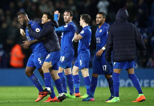 Wes Morgan of Leicester City celebrates with team mates after the full time whistle.