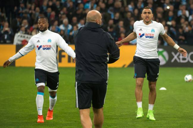 Olympique de Marseille French defender Patrice Evra and Olympique de Marseille's French forward Dimitri Payet warm up ahead El Classique