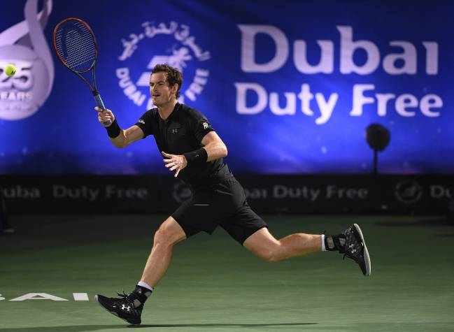Andy Murray of Scotland plays a forehand during his match against Malek Jaziri of Tunisia on day three of the ATP Dubai Duty Free Tennis Championship