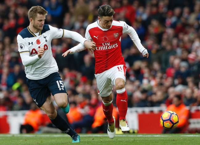 Mesut Ozil on the ball against Tottenham's Eric Dier.