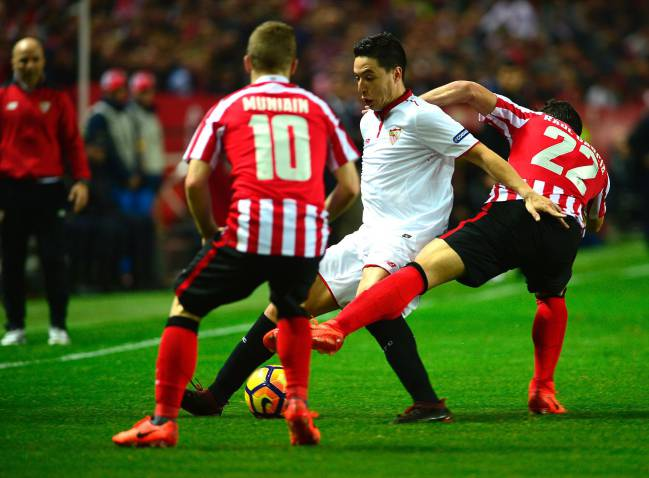 Athletic's midfielder Raul Garcia vies with Sevilla's French forward Samir Nasri.