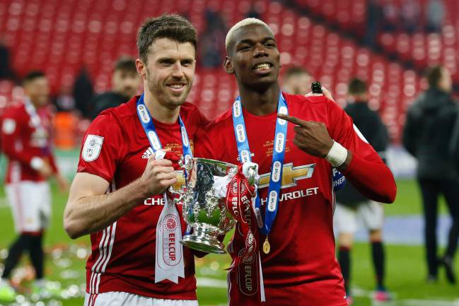 Manchester United's French midfielder Paul Pogba and Manchester United's English midfielder Michael Carrick