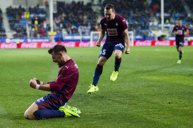 Up close and personal: Sergi Enrich of SD Eibar celebrates after scoring his team's third goal during the La Liga match between SD Eibar and Malaga.