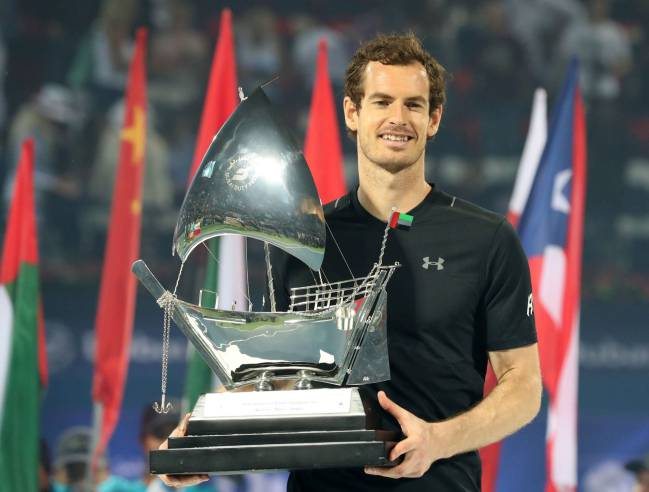 World number one Andy Murray of Great Britain celebrates with the championship trophy.