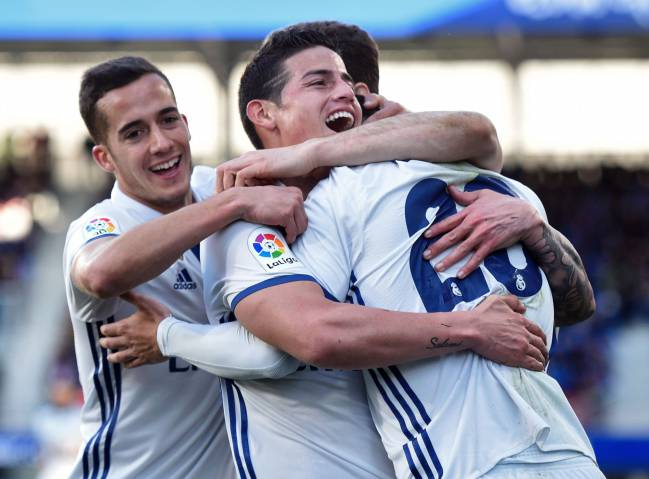 Real Madrid's Colombian midfielder James Rodriguez celebrates with Asensio and Lucas Vazquez in Eibar.