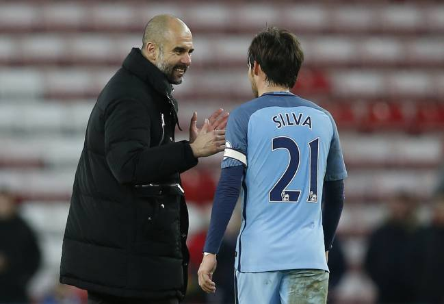 Manchester City manager Pep Guardiola with David Silva after the match
