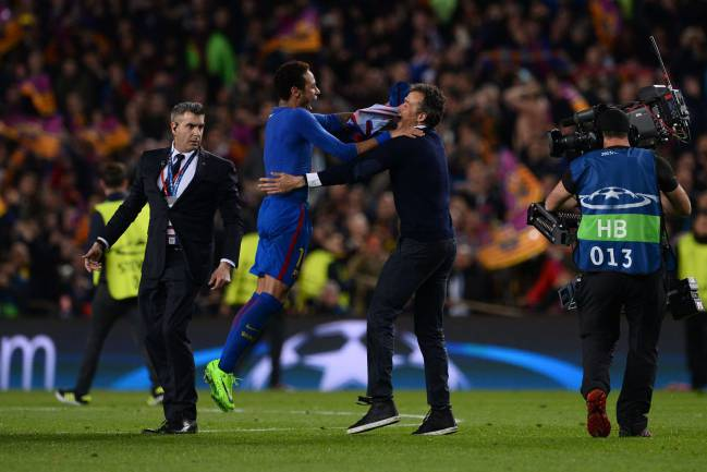 Barcelona's coach Luis Enrique celebrates with Barcelona's Brazilian forward Neymar after their 6-1 victory at the end of the UEFA Champions League round of 16 second leg