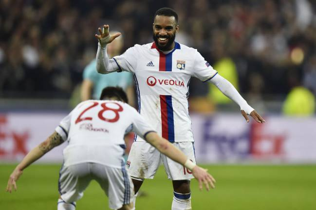 Alexandre Lacazette celebrates his stoppage-time strike against Roma.
