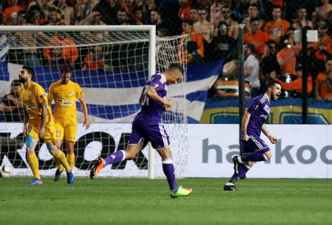 Anderlecht's Nicolae Stanciu wheels away in celebration after scoring against APOEL Nicosia.
