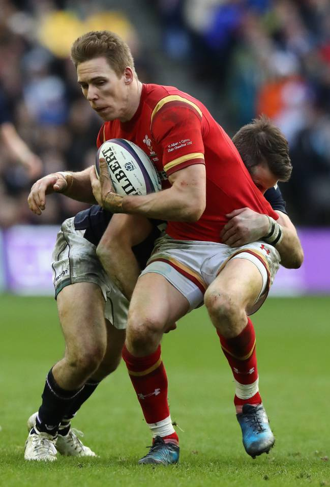 Liam Williams of Wales is held during the RBS Six Nations match against Scotland.