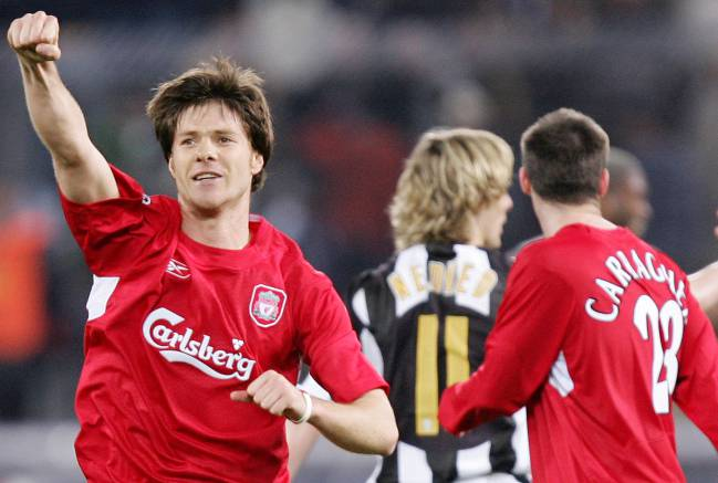 Xabi Alonso celebrates on the final whistle at Delle Alpi