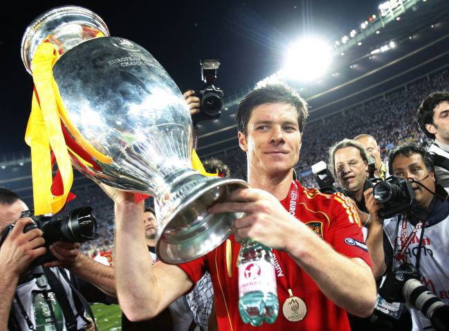 Spanish midfielder Xabi Alonso holds up the Trophy after Spain won the Euro 2008 championships.