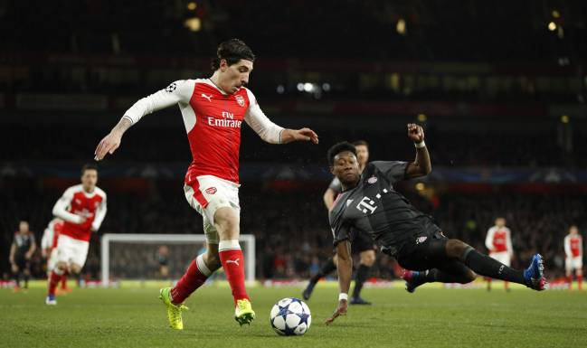 Arsenal's Hector Bellerin in action with Bayern Munich's David Alaba