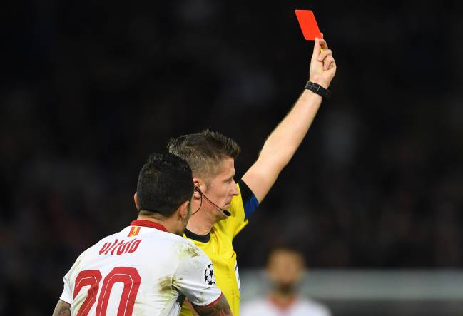 Vitolo of Sevilla remonstrates with referee Daniele Orsato of Italy as he shows the red card to Samir Nasri