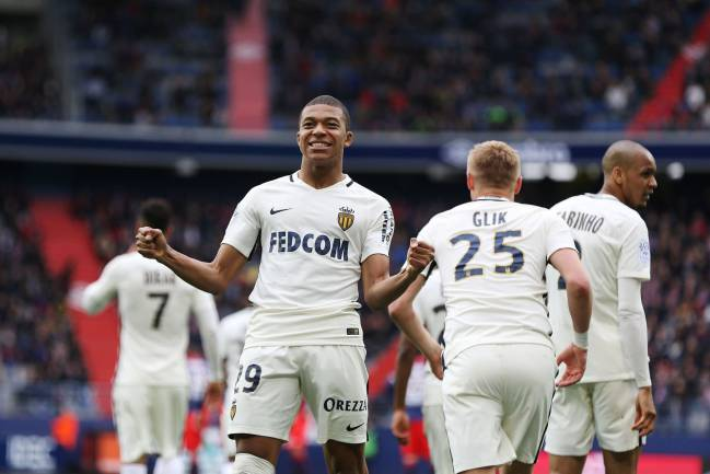 Monaco's French forward Kylian Mbappe Lottin celebrates.
