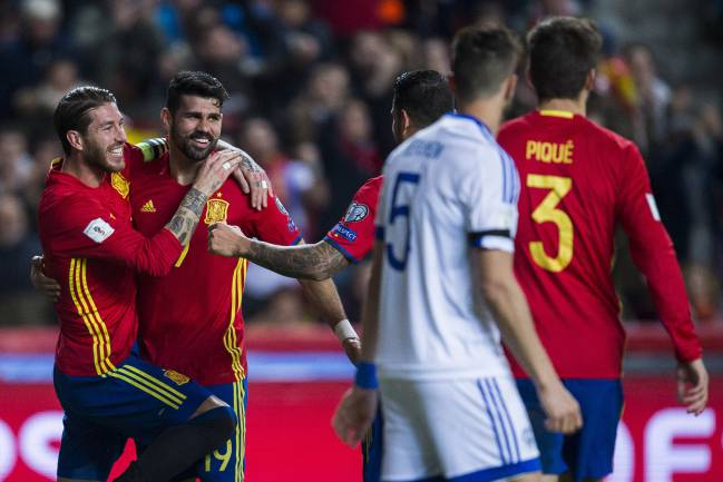 Diego Costa of Spain celebrates with his teammates Sergio Ramos of Spain after scoring his team's third goal