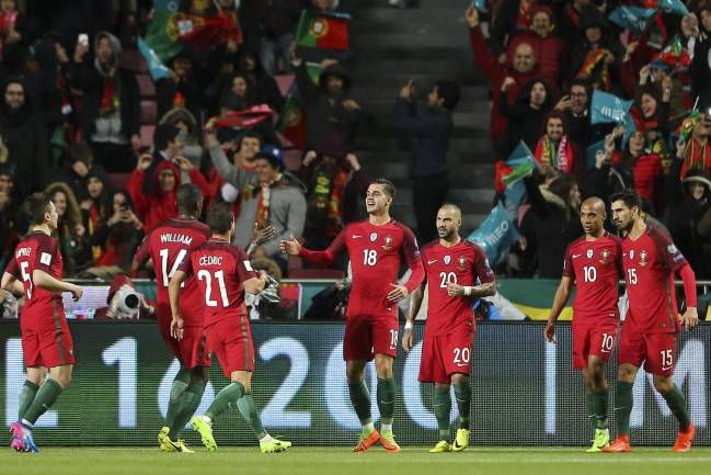 Portugal's player Andre Silva celebrates with his teammates after scoring a goal during the 2018 FIFA World Cup Russia group B qualifying soccer match
