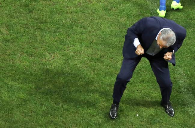Brazil's head coach Tite celebrates Philippe Coutinho's opening goal.