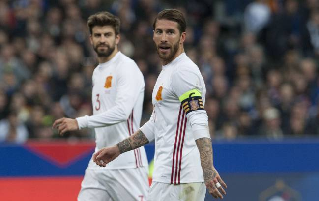 Piqué and Sergio Ramos in action for Spain last night