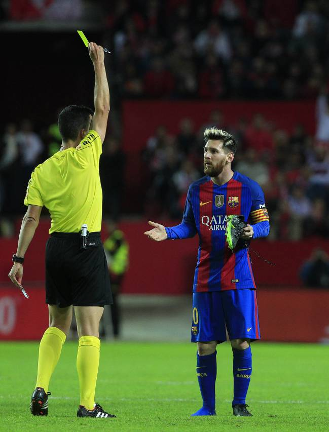 Barcelona's Messi receives yellow card.