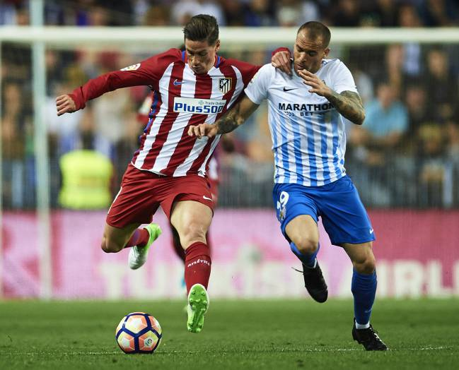 Fernando Torres of Atletico Madrid competes for the ball with Sandro Ramirez of Malaga
