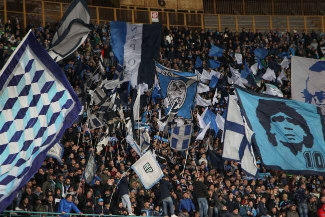 Napoli's fans cheer during the Italian Serie A football match SSC Napoli vs Juventus FC on April 2, 2017 at the San Paolo Stadium.