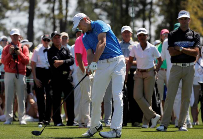 Masters champion Jordan Spieth is watched by Bubba Watson, Gary Player and Condoleezza Rice