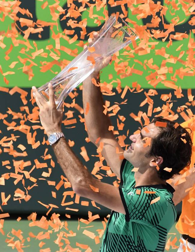 Roger Federer of Switzerland holds his trophy aloft in what is proving to be an excellent return to form.