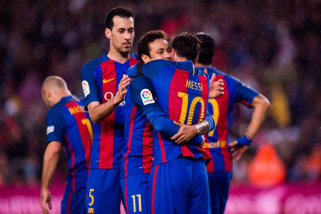 Lionel Messi of FC Barcelona celebrates with his teammates Neymar Santos Jr and Sergio Busquets