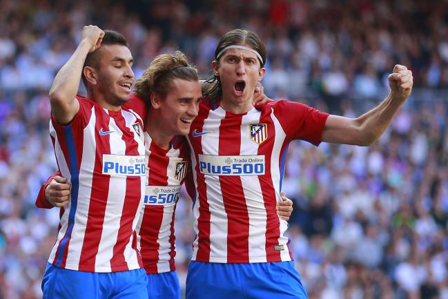 Antoine Griezmann of Atletico de Madrid celebrates scoring their opening goal with teammates Angel Martin Correa and Filipe Luis
