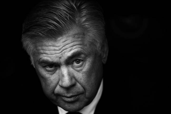 Carlo Ancelotti head coach of Bayern Munich sits on the bench during the Bundesliga match between Bayern and FC Augsburg.