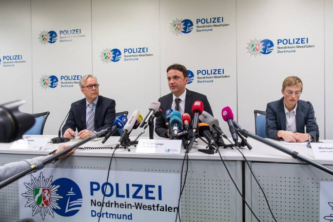 Gregor Lange, chief of Police Dortmund, Sascha Fligge, press officer of Borussia Dortmund and Sandra Luecke, public prosecutor, speak to the media.