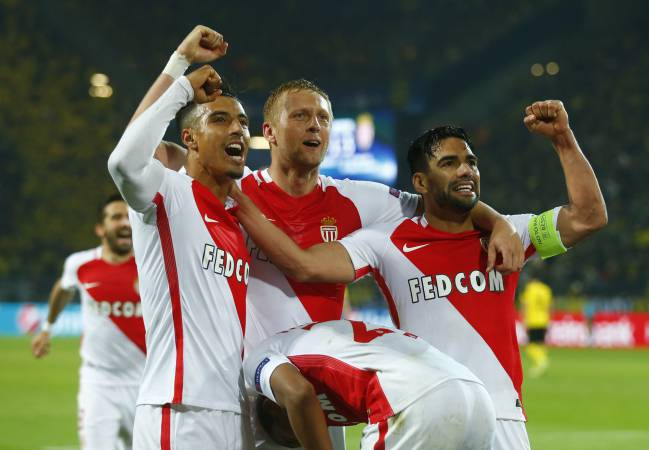 Monaco's Kylian Mbappe-Lottin celebrates scoring their third goal with Radamel Falcao and team mates.